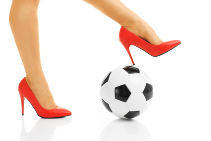 Picture of female legs in red heels and football